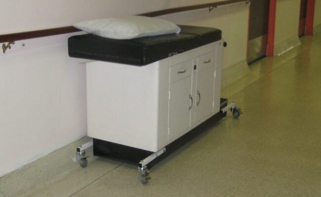QE Medical table with custom wheels for mobility
